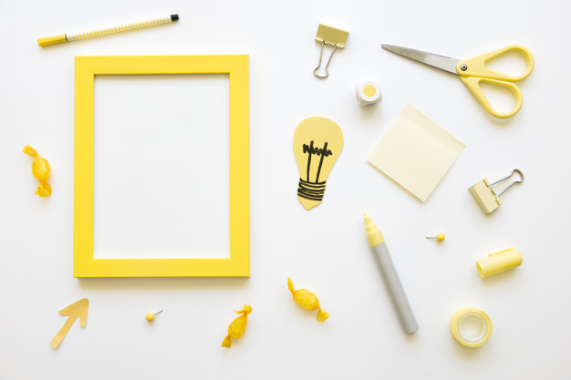 Candies-bulb-empty-frame-with-various-stationeries_23-2147865329